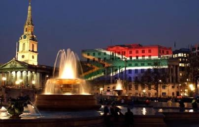 Trafalgar Square London with the South African Flag projected on to South Africa House